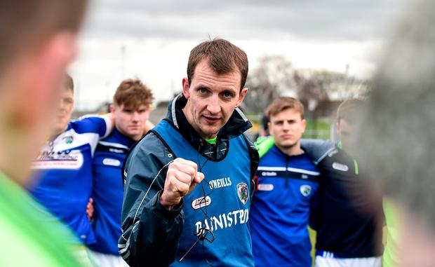 Laois manager John Sugrue speaks to his players following their side's victory during the Allianz Football League Division 4 Round 7 match between Carlow and Laois at Netwatch Cullen Park in Carlow. Photo by Seb Daly/Sportsfile