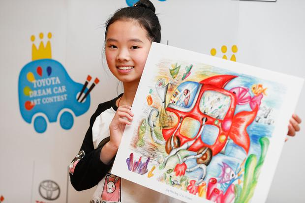 Gold winner Jing Wen Yang (12), from Foley Street, Dublin, with her painting 'The Ocean Cleaner' at the Toyota dream car art contest ceremony at Haughton House in Dublin Zoo. Photo: Conor McCabe