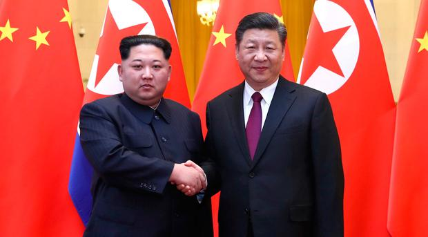 North Korean leader Kim Jong Un and Chinese President Xi Jinping shake hands at the Great Hall of the People in Beijing, China. Photo: Ju Peng/Xinhua via REUTERS