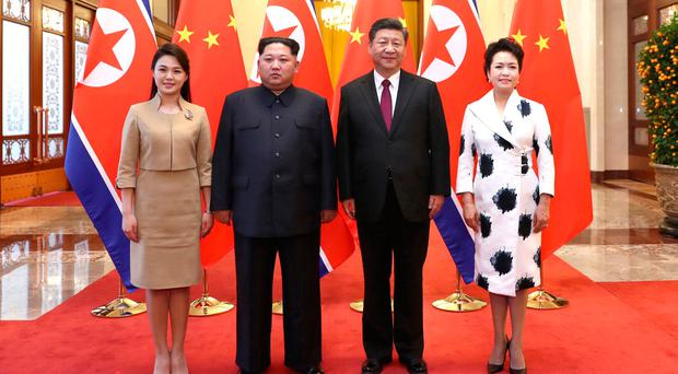 North Korean leader Kim Jong Un and wife Ri Sol Ju pose for a picture with Chinese President Xi Jinping and wife Peng Liyuan at the Great Hall of the People in Beijing, China. Ju Peng/Xinhua via REUTERS