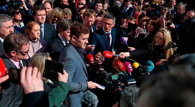 Ireland and Ulster rugby player Paddy Jackson (centre) speaking outside Belfast Crown Court after he was found not guilty of raping a woman Photo: Brian Lawless/PA Wire