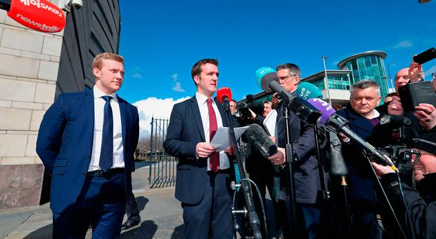 Ireland and Ulster rugby player Stuart Olding (left) and his solicitor Paul Dougan (centre) after he was found not guilty of raping a woman at a property in south Belfast in June 2016. Photo: Niall Carson/PA Wire