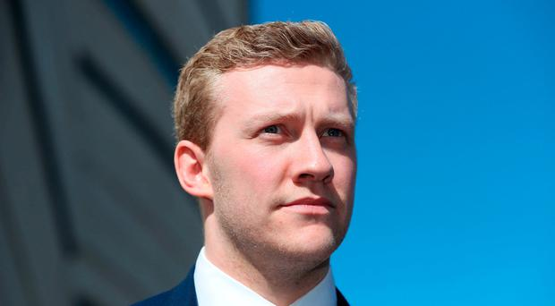 Ireland and Ulster rugby player Stuart Olding leaving Belfast Crown Court. Niall Carson/PA Wire