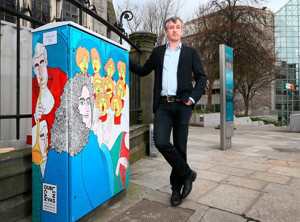 Electric dreams: David Murtagh pictured with 'Handle's Messiah' at the top of Fishamble Street in Dubin. Photo: Frank Mc Grath