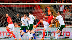 Mehmet Topal of Turkey scores his side's goal against Ireland