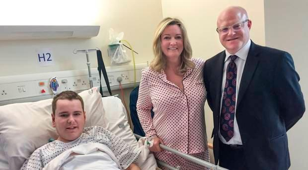 Mark Dobson with his mother Jo-Anne and consultant surgeon Tim Brown
