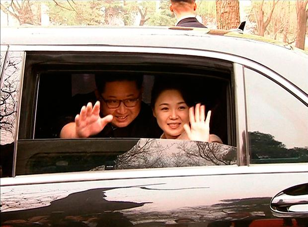 This video grab taken from footage released by China Central Television (CCTV) yesterday shows North Korea's leader Kim Jong Un and his wife Ri Sol Ju waving goodbye as they depart by car following a meeting with China's President Xi Jinping in Beijing this week. Photo: CCTV/AFP/Getty