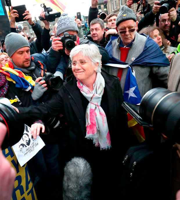 Clara Ponsati greets supporters outside Edinburgh Sheriff Court after she was bailed. Photo: Jane Barlow/PA