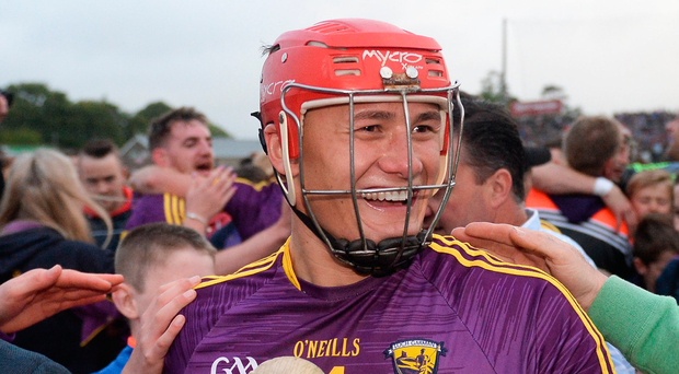 Lee Chin is mobbed by Wexford fans after last summer's Leinster SHC victory over Kilkenny. Photo: Sportsfile