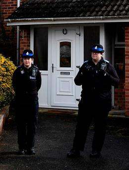 Police officers stand guard outside of the home of former Russian military intelligence officer Sergei Skripal, in Salisbury, England, earlier this month. Photo: Reuters/Toby Melville
