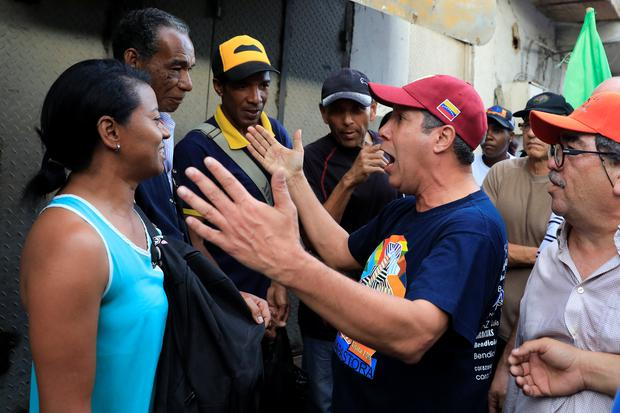 Venezuelan presidential candidate Henri Falcon speaks with a woman during a campaign event at the slum of Petare in Caracas Photo: REUTERS/Marco Bello