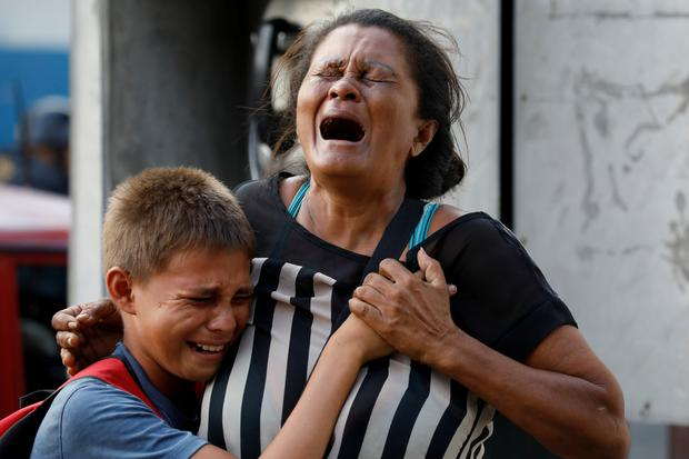 Relatives of inmates held at the General Command of the Carabobo Police react as they wait outside the prison Photo: REUTERS/Carlos Garcia Rawlins
