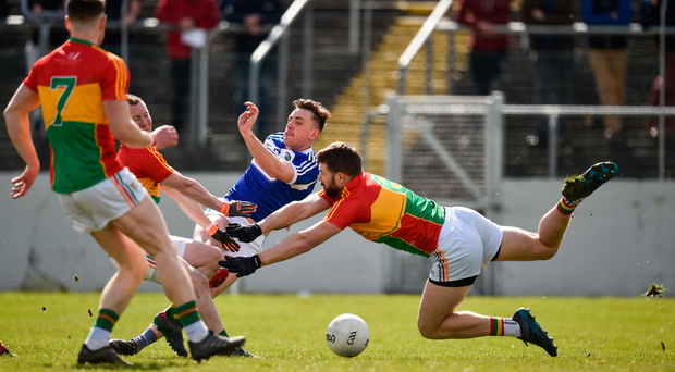 25 March 2018; Gary Walsh of Laois shoots to score his side's first goal of the game under preasure from Danny Moran and Daniel St Ledger of Carlow during the Allianz Football League Division 4 Round 7 match between Carlow and Laois at Netwatch Cullen Park in Carlow. Photo by Seb Daly/Sportsfile