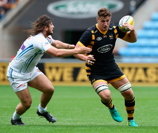 COVENTRY, ENGLAND - SEPTEMBER 04: Sam Jones of Wasps is tackled by Alec Hepburn during the Aviva Premiership match between Wasps and Exeter Chiefs at the Ricoh Arena on September 4, 2016 in Coventry, England. (Photo by David Rogers/Getty Images)