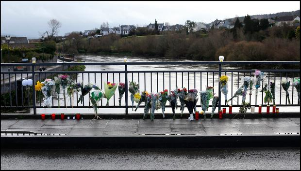 Flowers left at the Dillon Bridge on the River Suir as Elisha Gault was buried. Pic Steve Humphreys
