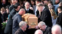 Elisha Gault's parents Grainne (left of coffin) and Cameron (back left) at her funeral mass at the Church of the Assumption in Piltown Co Kilkenny. Photo: Steve Humphreys