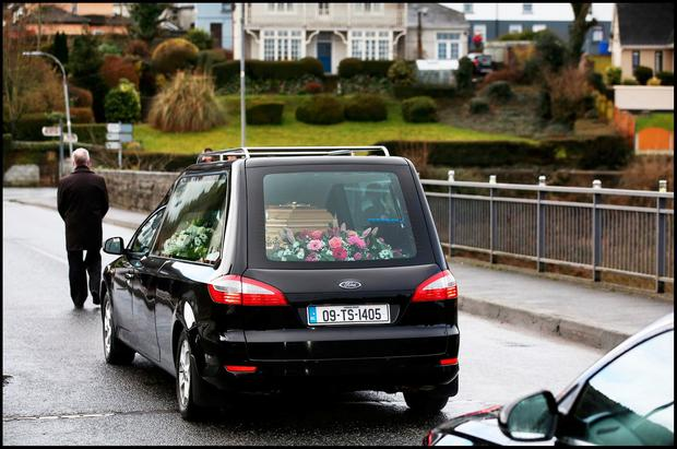 Elisha Gault's remains cross the Dillon Bridge where her parents threw flowers into the Suir River before her funeral mass at the Church of the Assumption in Piltown Co Kilkenny. Picture: Steve Humphreys