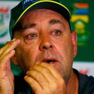Australian cricket coach Darren Lehmann reacts as he briefs media