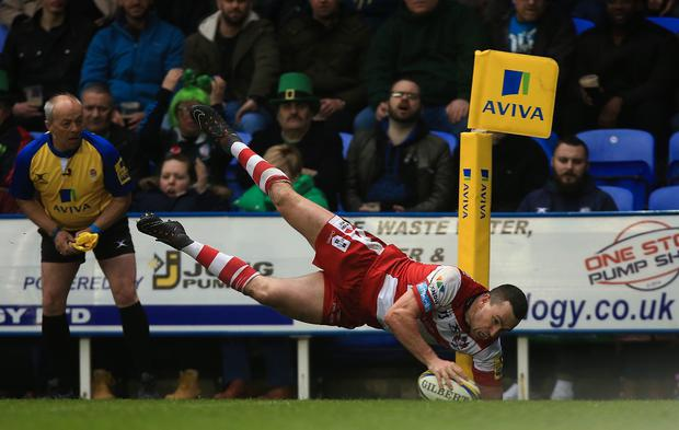 Tom Marshall of Gloucester dives to score a try during the Aviva Premiership match between London Irish and Gloucester Rugby at the Madejski Stadium last weekend. Photo: Ben Hoskins/Getty Images