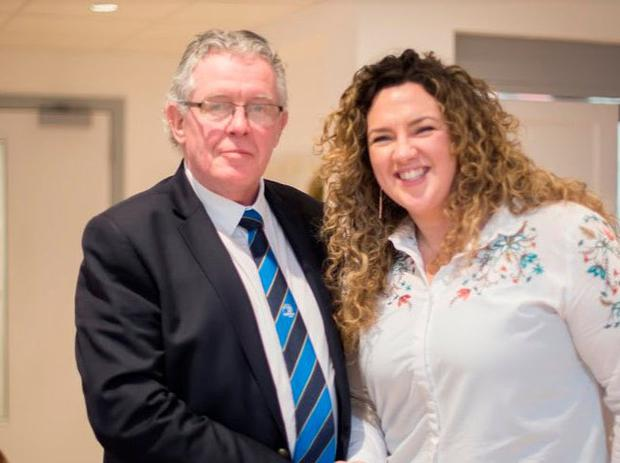 Leinster's president-elect Robert Deacon with Railway Union club captain Aoife Maher Photo: Cian Ryan