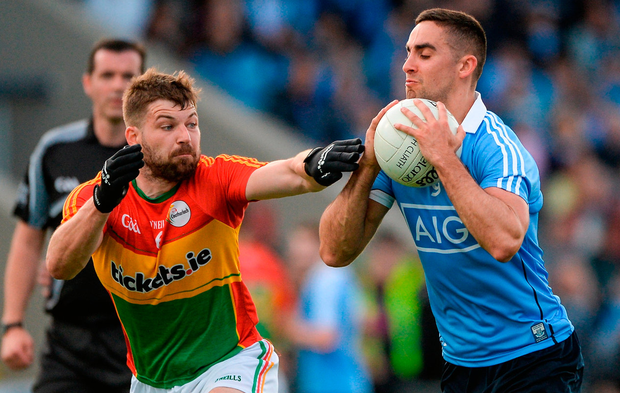 Daniel St Ledger (left) in action against James McCarthy of Dublin last summer. Photo: Daire Brennan/Sportsfile