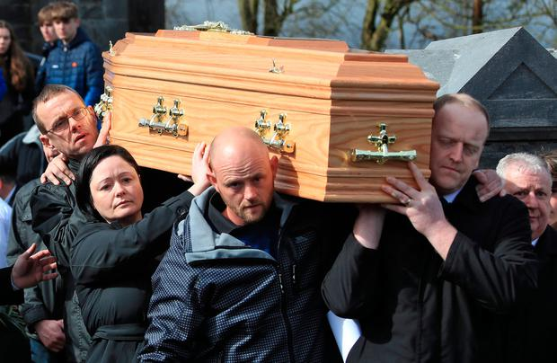 Heartbreaking goodbye: Elisha's parents, Gráinne and Cameron (centre, and back left of coffin), help to carry her coffin into the Church of the Assumption in Piltown. Photo: Collins
