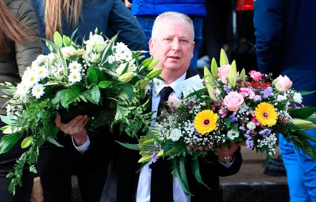 Mourners delivered floral tributes to the tragic teenager. Photo: Collins