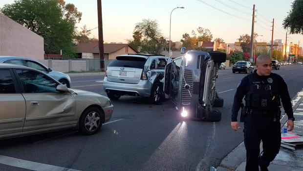 The self-driven Volvo SUV owned and operated by Uber Technologies lies on its side after the collision in Tempe, Arizona, in which a woman died. Photo: Reuters