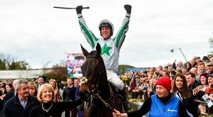 Jockey Robbie Power celebrates as he enters the parade ring after winning the Boylesports Irish Grand National Steeplechase on Our Duke during the Fairyhouse Easter Festival in 2017