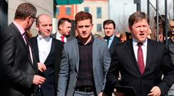 Paddy Jackson (centre) leaving Belfast Crown Court following his acquittal. Photo: PA.