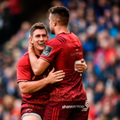 Ian Keatley of Munster is congratulated by team-mate Conor Murray