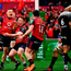 Andrew Conway of Munster celebrates with team-mates after scoring their side's second try