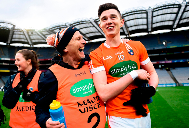 Armagh selector Jim McCorry celebrates with Ben Crealey