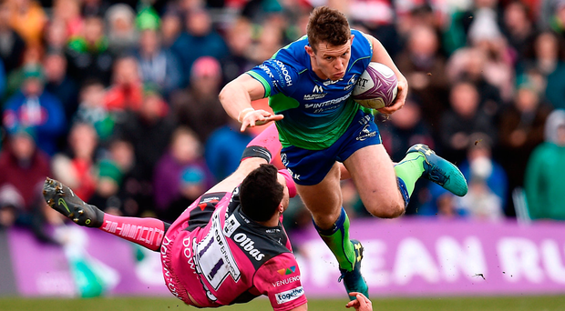Matt Healy of Connacht is tackled by Tom Marshall during the European Rugby Challenge Cup. Photo: Sportsfile