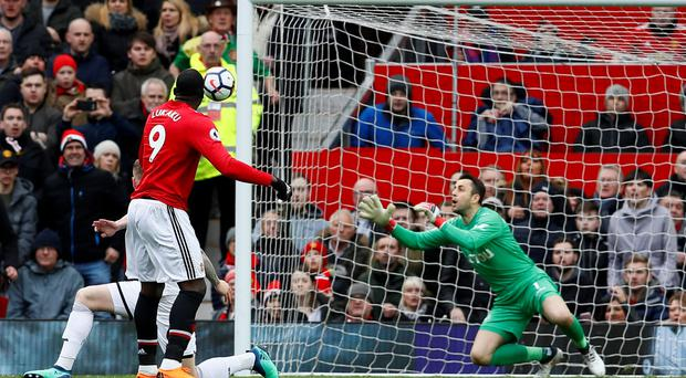 Romelu Lukaku opens the scoring against Swansea with his 100th goal in the Premier League. Photo: Reuters
