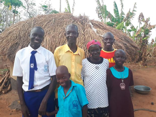 THANK YOU: Daniel today with his family, Cockson (10), parents Joel and Betty, Emmanuel (19), and Vicky (11)