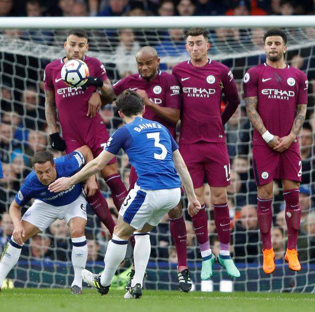 Everton's Leighton Baines shoots from a free kick. Photo: Reuters