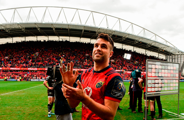 Conor Murray of Munster applauds supporters