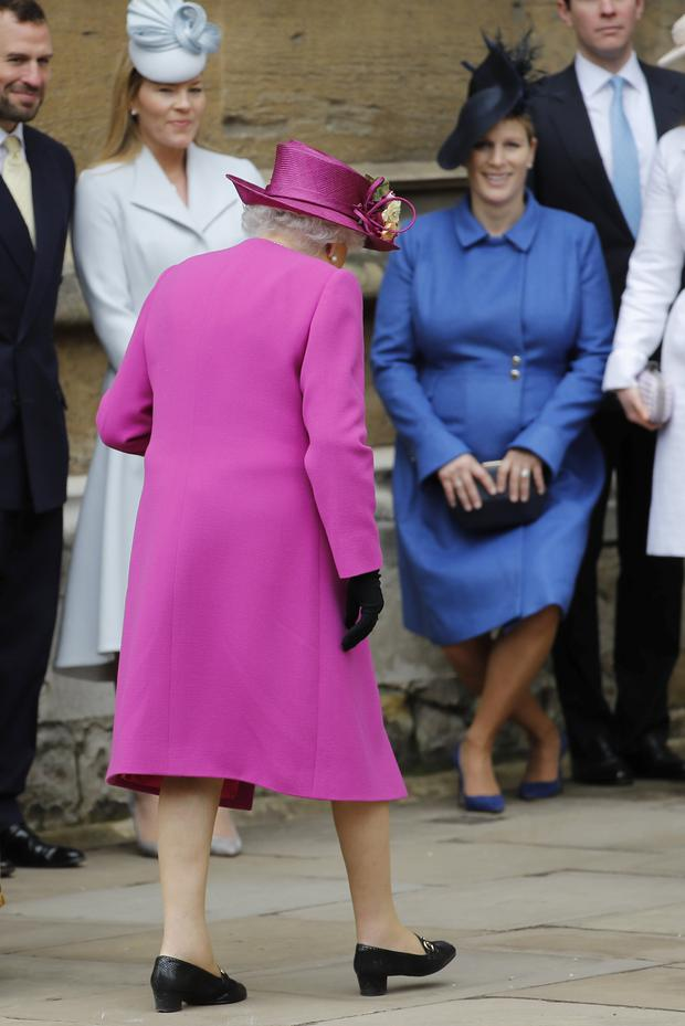 Pregnant Zara Phillips curtseys to Britain's Queen Elizabeth at St George's Chapel at Windsor Castle in Windsor, Britain. Tolga Akmen/Pool via Reuters