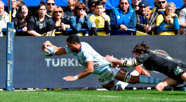 Racing92's French flanker Boris Palu (L) scores a try