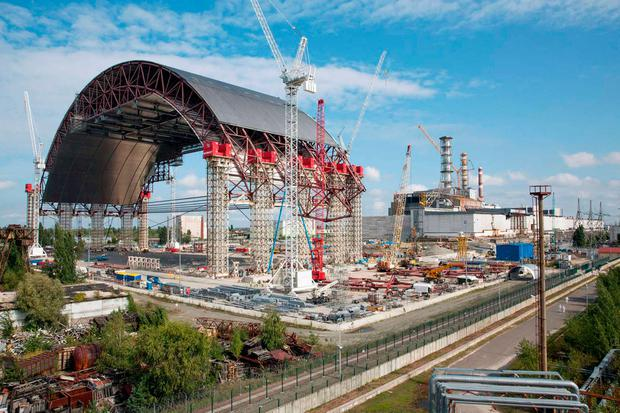 Today's Chernobyl Arch, completed in 2016, contains the remains of No 4 reactor unit