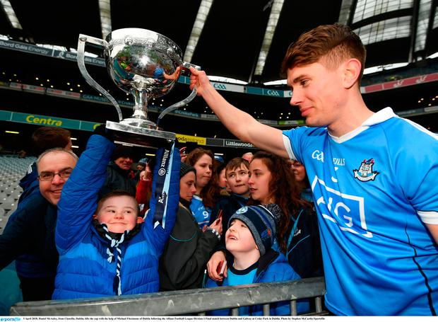 1 April 2018; Daniel McAuley, from Clonsilla, Dublin, lifts the cup with the help of Michael Fitzsimons of Dublin following the Allianz Football League Division 1 Final match between Dublin and Galway at Croke Park in Dublin. Photo by Stephen McCarthy/Sportsfile