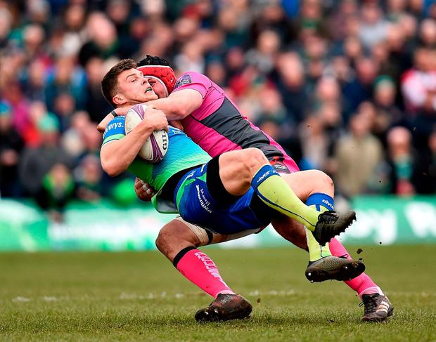 Tom Farrell is stopped by Ben Morgan of Gloucester during the quarter-final clash at the Sportsground. Photo: Seb Daly/Sportsfile