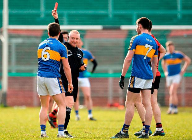 Referee Barry Cassidy issues Robbie Kiely of Tipperary with a red card. Photo: Oliver McVeigh/Sportsfile