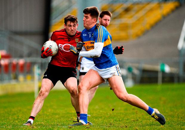 Niall Donnelly of Down goes shoulder-to-shoulder with Tipperary's Steven O'Brien. Photo: Oliver McVeigh/Sportsfile