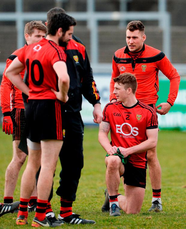 Dejected Down players at the end of the match in Newry. Photo: Oliver McVeigh/Sportsfile