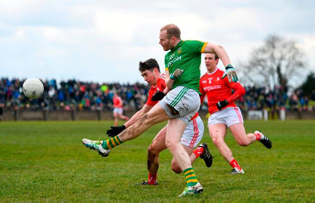 Meath's Sean Tobin launches the ball forward. Photo: Ramsey Cardy/Sportsfile