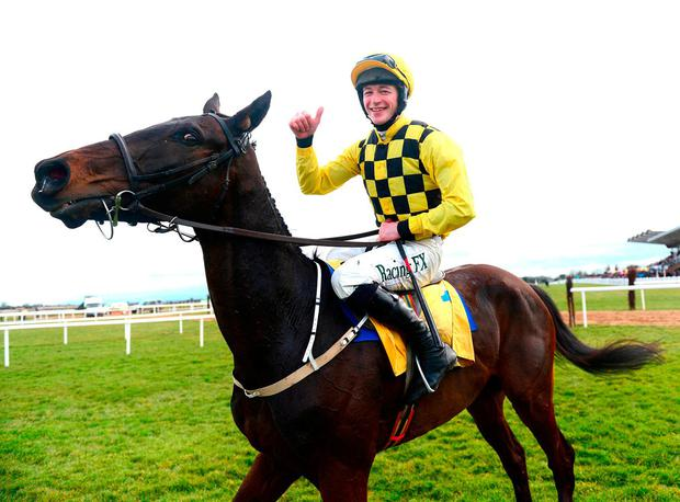 Al Boum Photo and jockey David Mullins. Photo: PA Wire.
