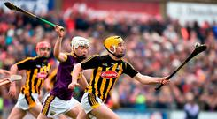Richie Leahy of Kilkenny keeps his eye on the sliotar as he tries to escape the clutches of Wexford's Rory O'Connor. Photo: Matt Browne/Sportsfile
