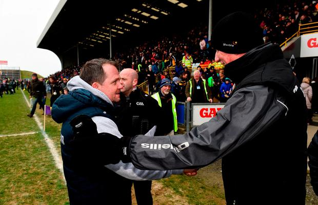 Wexford manager Davy Fitzgerald and Kilkenny manager Brian Cody shake hands after their semi-final clash. Photo: Matt Browne/Sportsfile